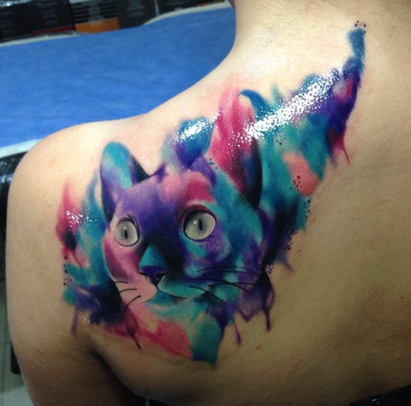 Big multicolored shoulder tattoo of watercolor like cat portrait