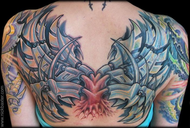 Big multicolored upper back tattoo of interesting alien technology