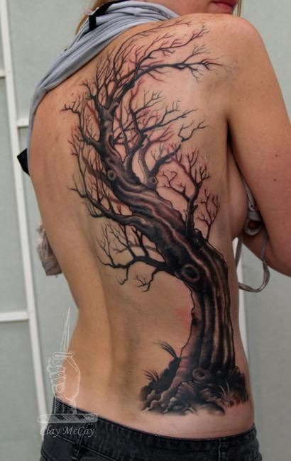Big mystic designed colored old tree tattoo on back