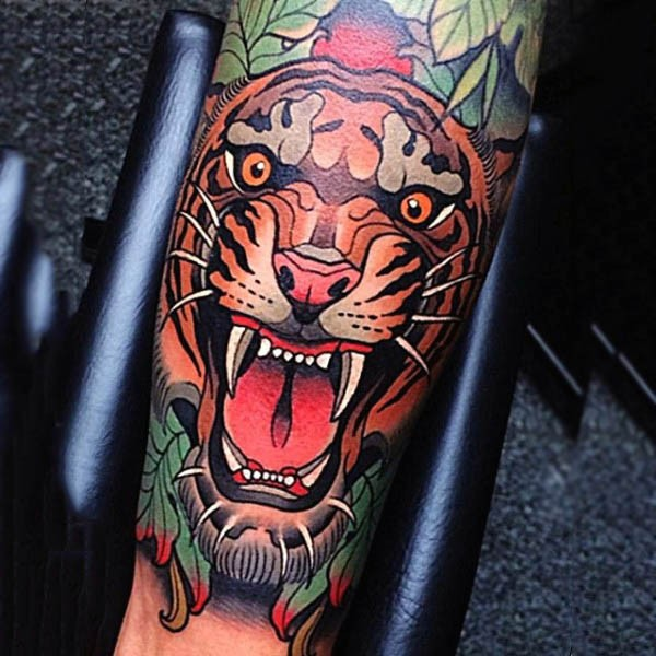Big natural colored roaring tiger tattoo on forearm