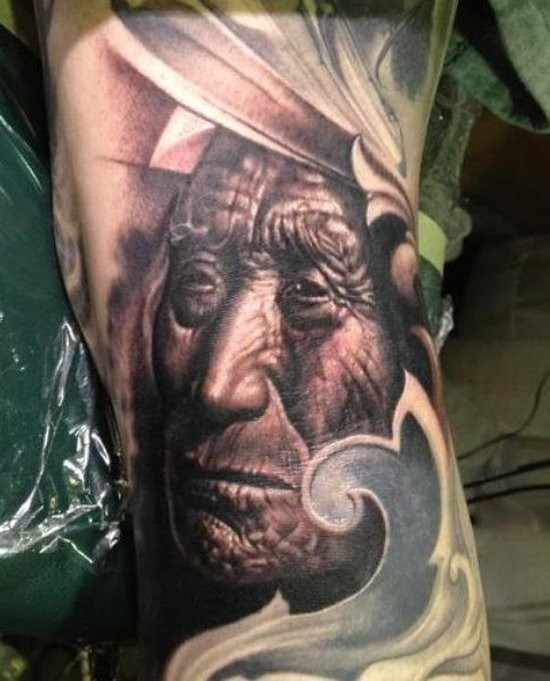 Big natural looking black and white old Indian portrait tattoo on arm