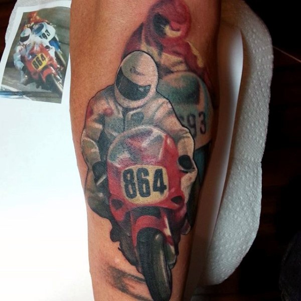 Big natural looking colored bike race tattoo on arm