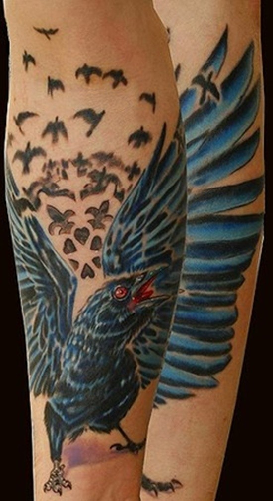Big natural looking crow tattoo on forearm