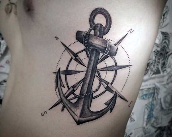 Big nautical themed anchor with compass tattoo on side