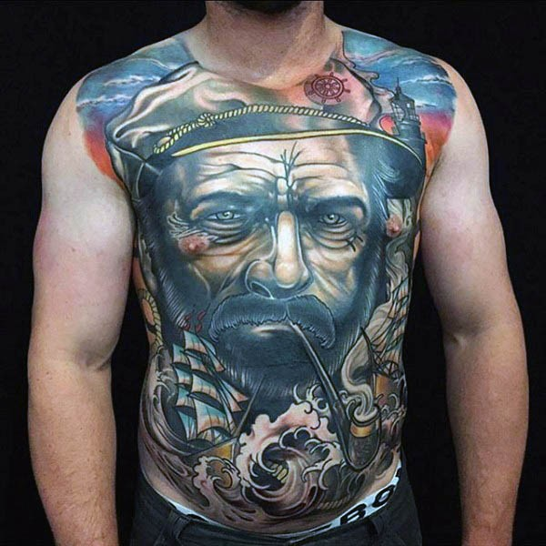 Big nautical themed colored tattoo on whole chest and belly of smoking sailor and sailing ship