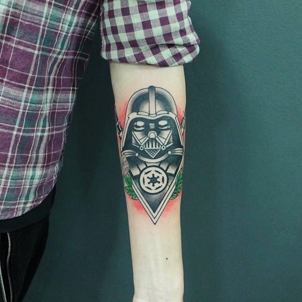Big old school colored Vader Mask tattoo on forearm stylized with Empire emblem