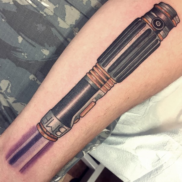Big old school very detailed natural looking lightsaber tattoo on forearm stylized with lettering