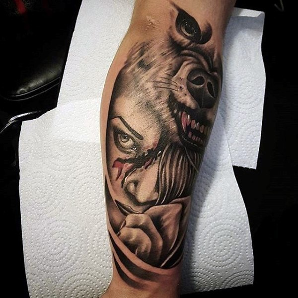 Big original combined wolf face with bloody woman portrait forearm tattoo