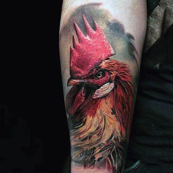 Big real photo like multicolored cock head tattoo on arm