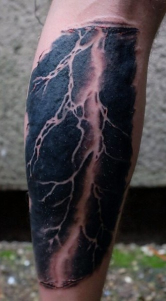 Big realistic looking black and white lightning tattoo on leg