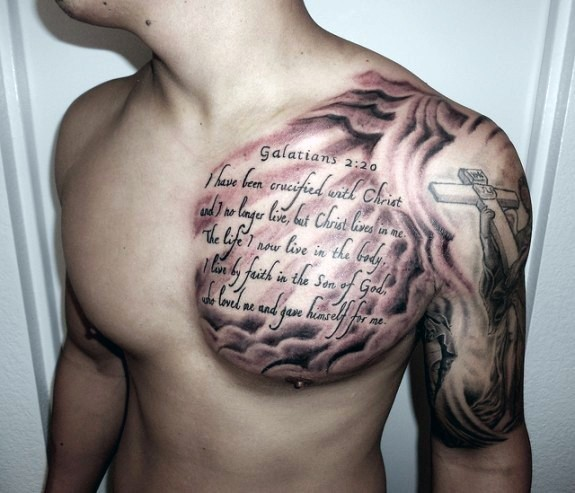 Big religious themed black ink lettering tattoo on chest
