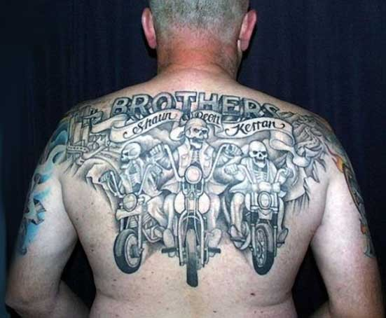 Big skeletons bikers on motorcycles tattoo on back