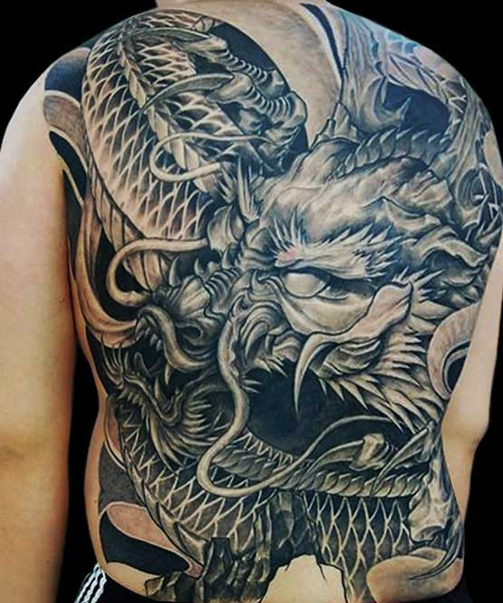 Big spooky japanese dragon tattoo
