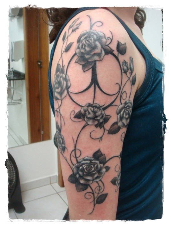 Big traditional painted black and white floral tattoo on shoulder area