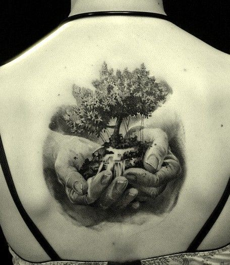 Big tree in hands tattoo on back