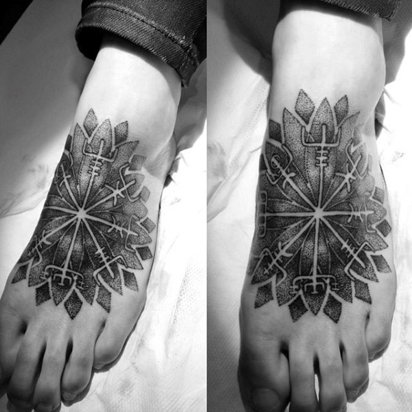 Big tribal style flower shaped tattoo on foot