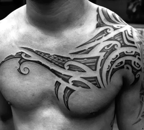 Big tribal style simple ornaments tattoo on chest