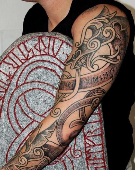 Big typical colored sleeve tattoo of medieval ornaments and lettering
