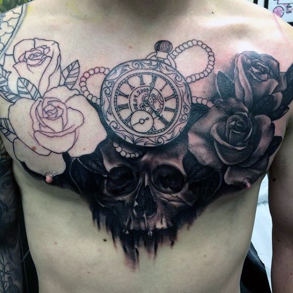 Big unfinished half colored flowers with skull and old antic clock tattoo on chest