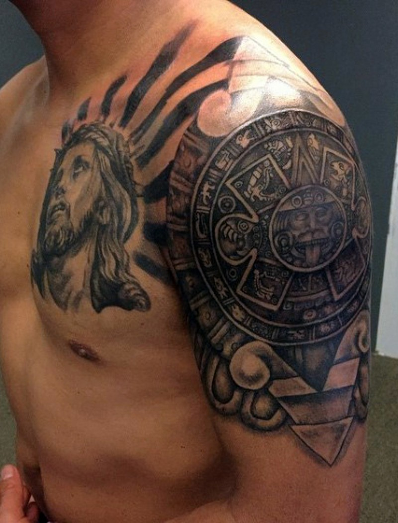 Big unique combined black ink shoulder and chest tattoo of Jesus portrait and antic Mayan tablet