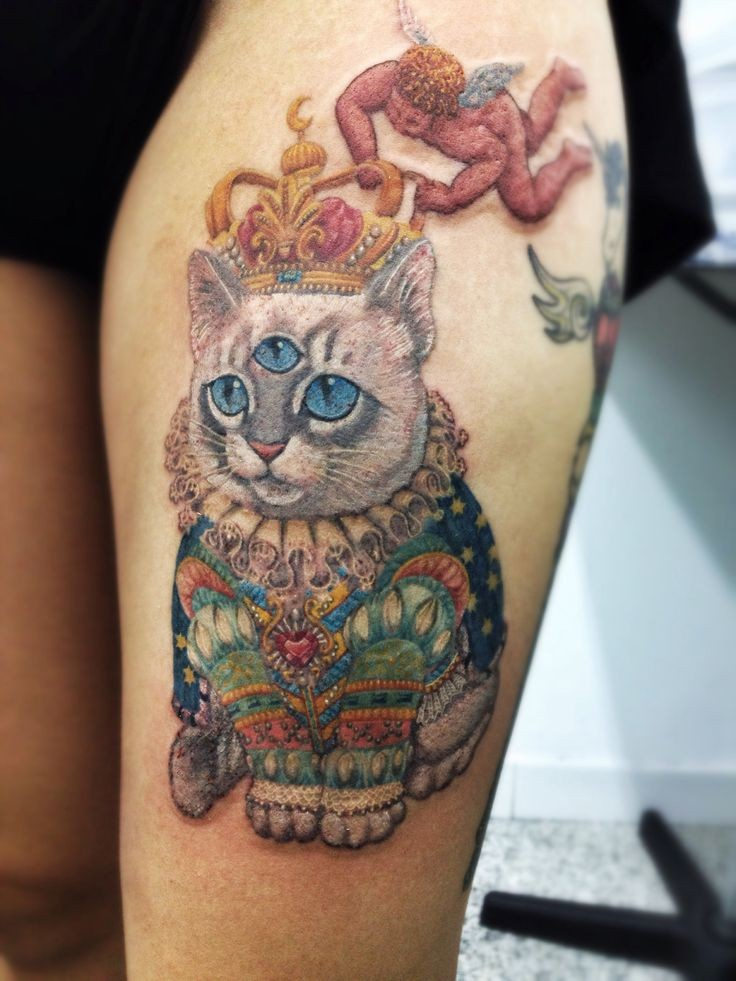 Big unique designed colorful royal cat tattoo on thigh zone