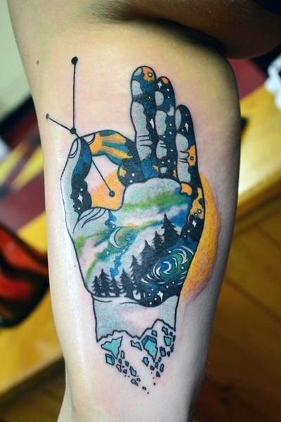 Big unique multicolored and with night sky and forest tattoo on arm
