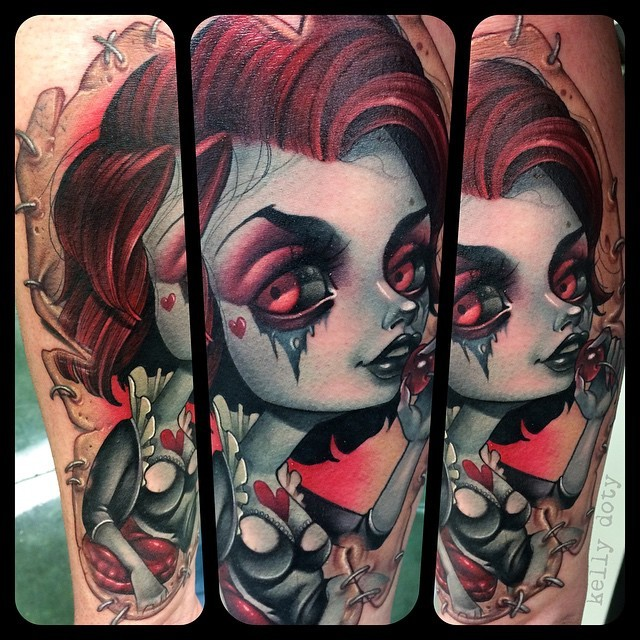 Big very beautiful painted and colored evil witch tattoo on forearm stylized with red hearts
