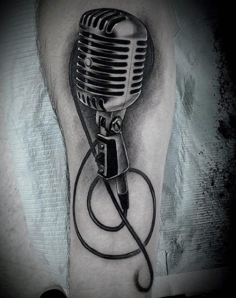 Big very detailed black and white vintage microphone tattoo on leg