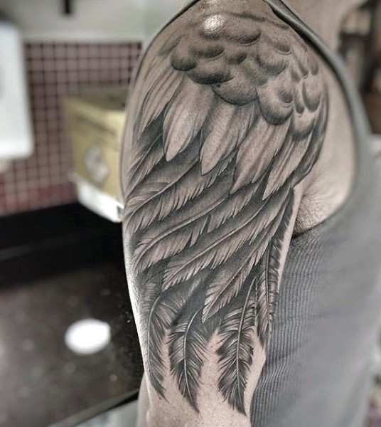 Big very detailed black and white wing shoulder tattoo
