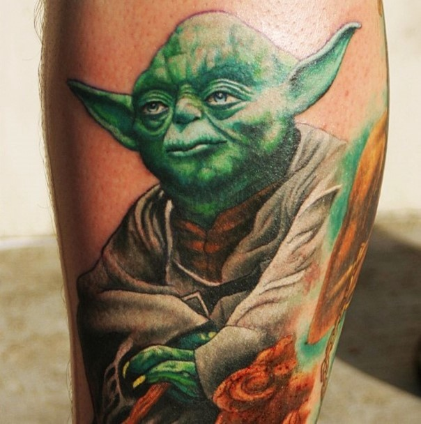 Big very detailed colorful master Yoda tattoo on leg