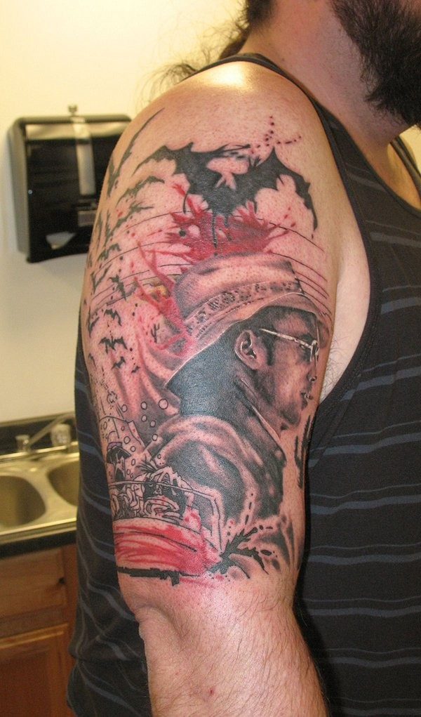 Big very detailed western cowboy in sun glasses tattoo ob shoulder with bats