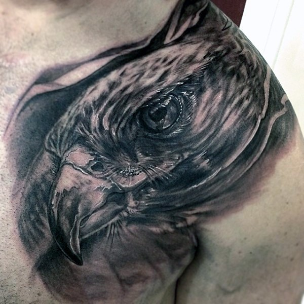 Big very realistic looking black ink detailed eagle tattoo on chest