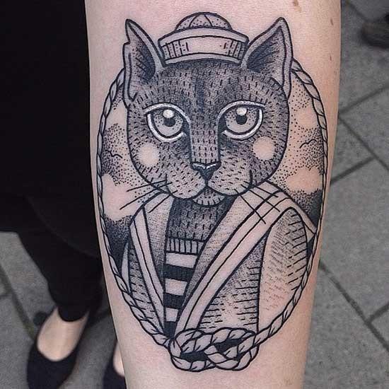 Big vintage style black ink forearm tattoo of sailor cat portrait