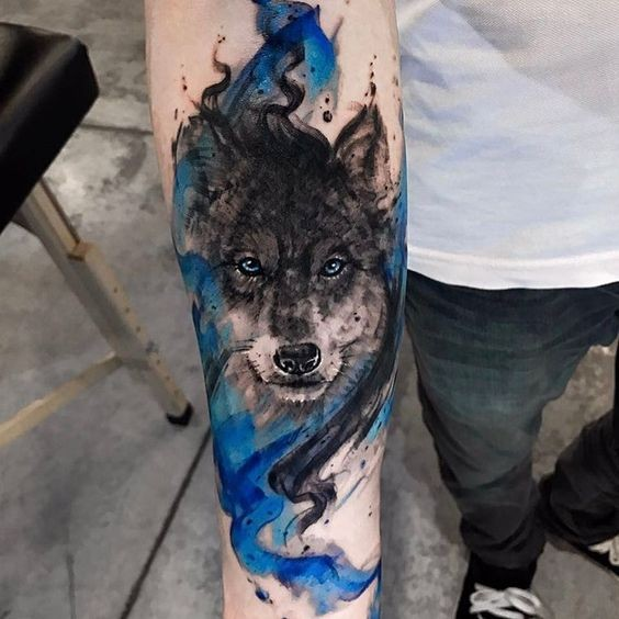 Big watercolor style forearm tattoo of strange wolf