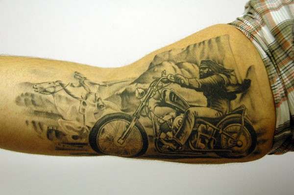 Biker and rider tattoo on arm