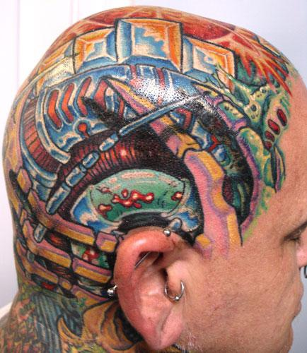 Biomechanic parti-coloured head tattoo,different objects