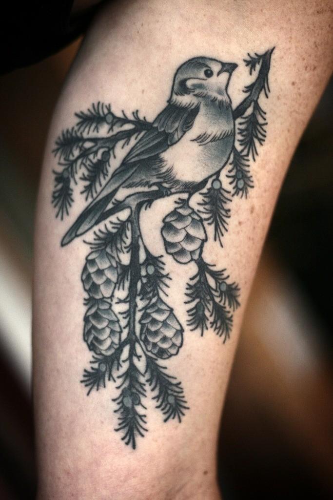 Tatuaggio sul braccio l&quotuccello bianco nero sul pino