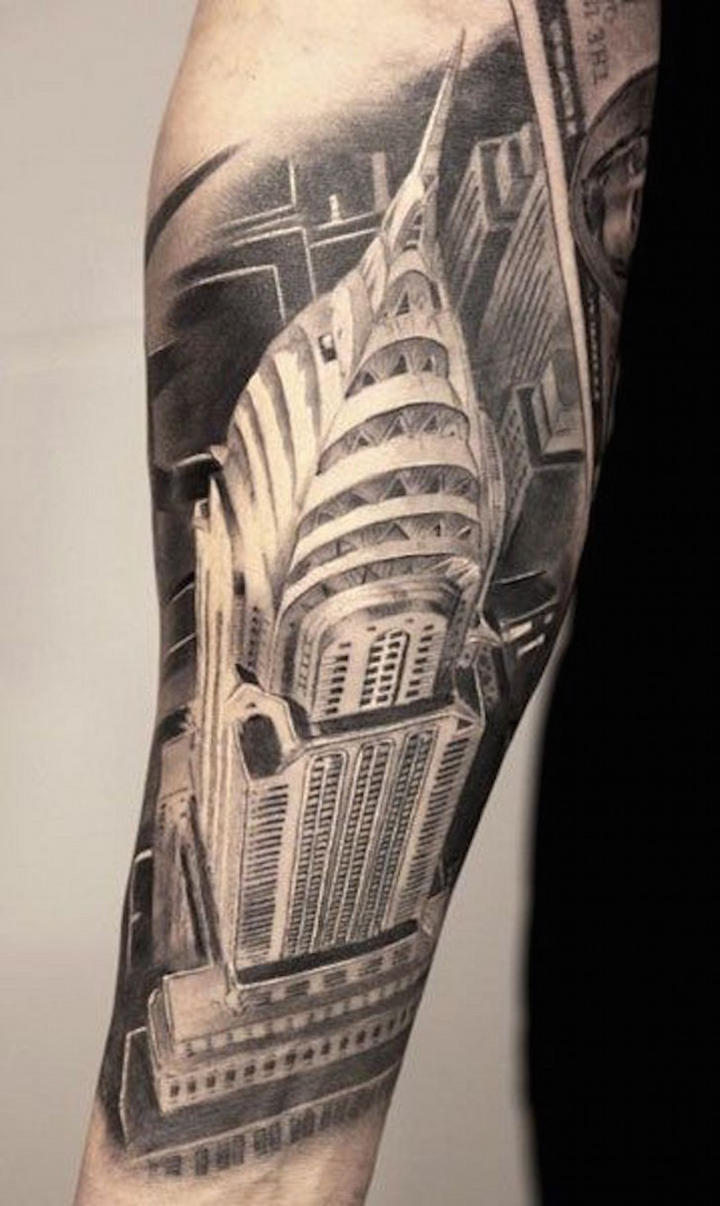 Bird view like black and white detailed forearm tattoo of Empire State Building