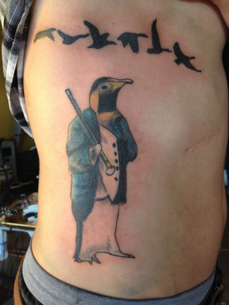 Birds and penguin tattoo on ribs