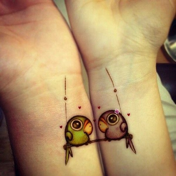 Birds in cute friendship tattoos on wrists