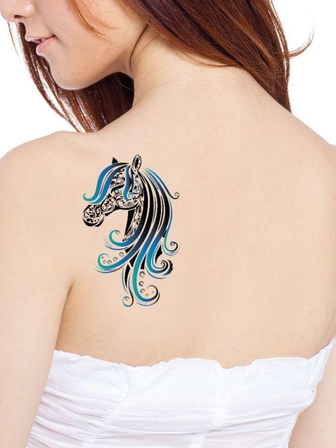 Black and blue horse tattoo on shoulder blade