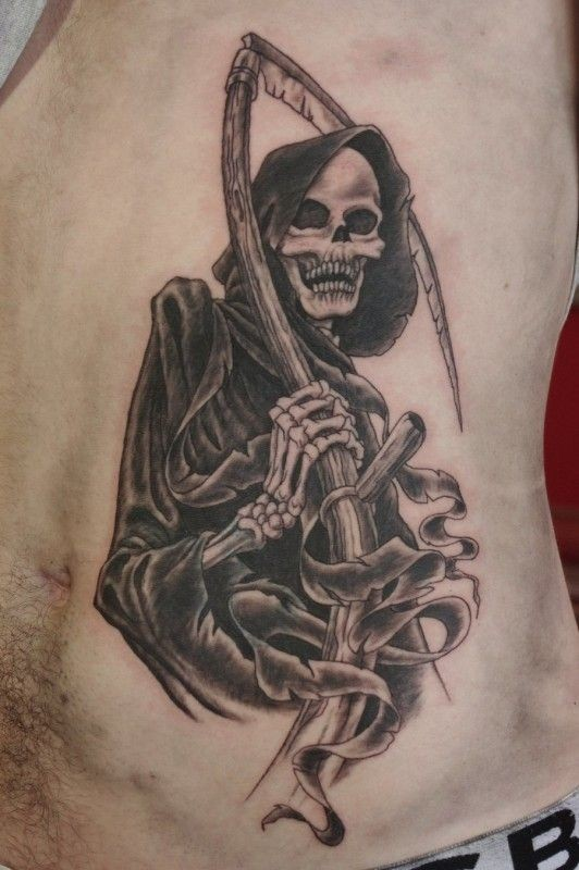 Black and gray death with scythe tattoo on ribs