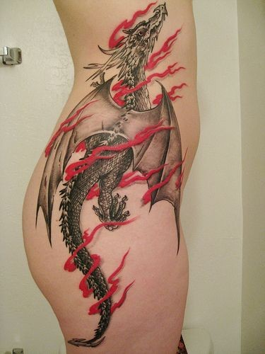 Black and gray dragon with red ribbon tattoo on ribs
