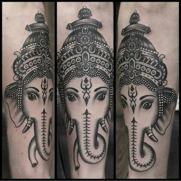 Black and gray ganesha head tattoo by Paul Aherne