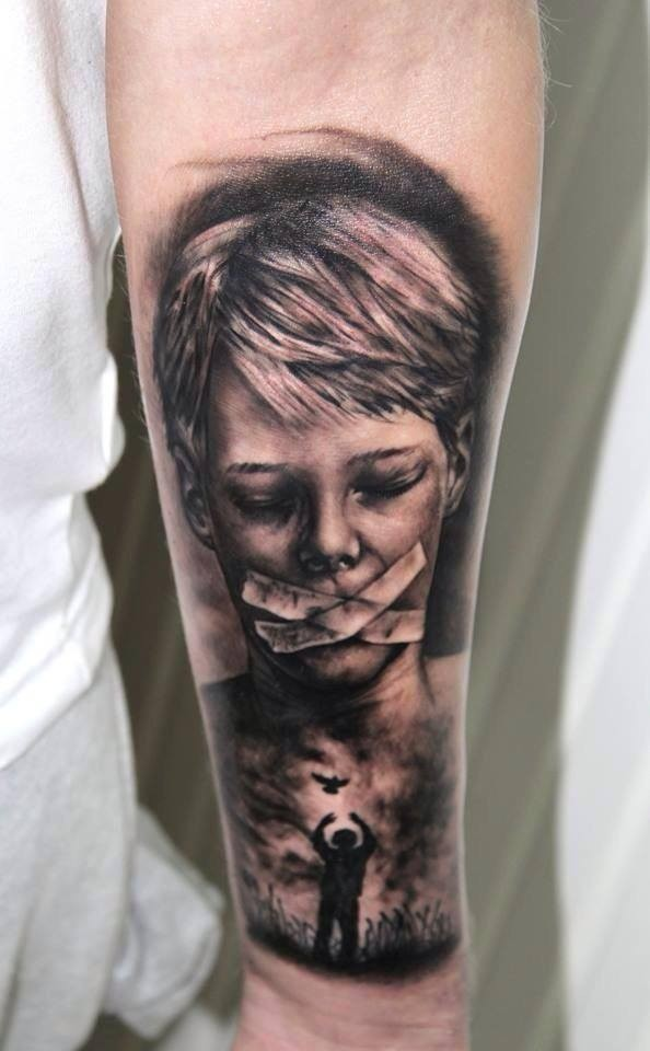 Black and gray horror style medium size boy with taped mouth tattoo on forearm