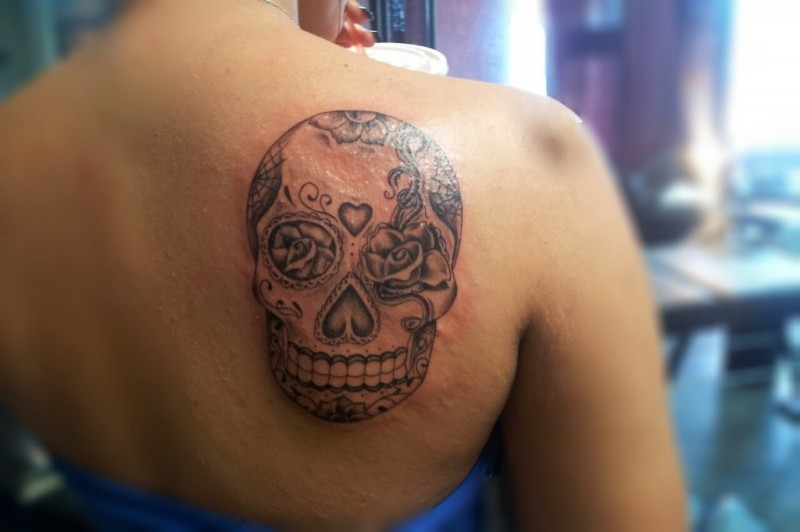 Black and gray mexican sugar skull tattoo on shoulder blade