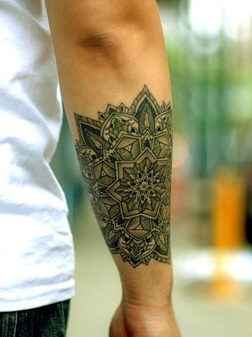 Black and gray ornament forearm tattoo
