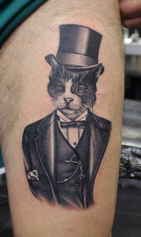 Black and gray portrait of a gentleman cat tattoo by Phatt German