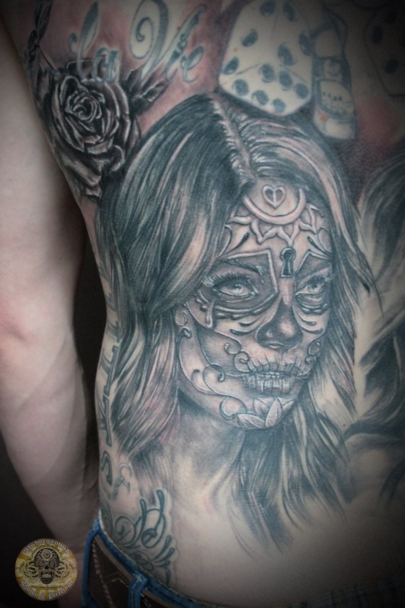 Black and gray santa muerte tattoo on back