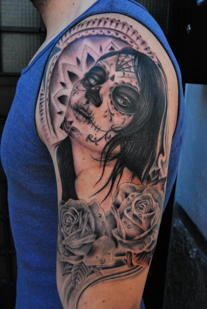 Black and gray santa muerte with roses tattoo on shoulder